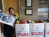 KeyPoint employee donating toys to Tots For Tots